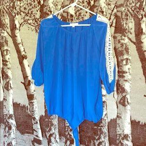Blue shirt with crochet sleeve detail